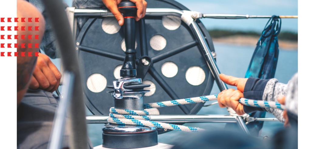 People pulling rope on boat winch